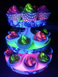 Black light glowing cupcakes and stand. The key to 'glow in the dark' cupcakes, you ask? Tonic Water!