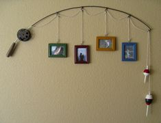 Old Fishing Pole...re-purposed into a unique & rustic picture hanging decoration for the wall.  Just attach assorted pictures by string on the pole and hang up.