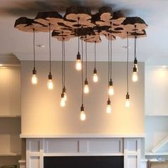Extra Large Live-Edge Olive Wood Chandelier. Rustic And Industrial Light Fixture by Paul Miller