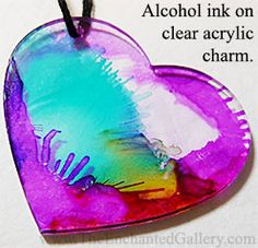 Alcohol ink dripped then blown with a straw onto a clear acrylic heart charm pendant. Ranger Tim Holtz brand inks on The Enchanted Gallery laser cut jewelry making supplies. www.TheEnchantedGallery.com