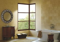 These windows do not open, but they can be customized in nearly any angle or shape you desire. They are often found in modern- or contemporary-style houses in conjunction with operating windows. Photo courtesy of Marvin Windows