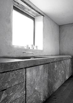Beautiful, tactile kitchen in natural stone by Joseph Dirand.