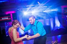 Awesome picture of a couple dancing at an event we did. The light show in the back looks amazing! #djs #weddings #lightshow #pros