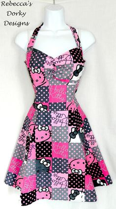 This adorable dress is made from a pink and grey cotton fabric featuring Hello Kitty!  The dress comes in a halter top style with two straps