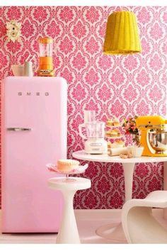 Cheery little yellow and pink kithcen in retro style with pink fridge ...<3  So cute!