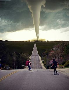 Skateboard skating longboard hills street trees hurricane scary wonderful magical rain storm hail skateboarding I don't care I love it