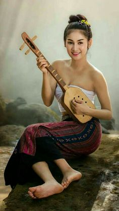 Beautiful Laos girl in Laos traditional costume. She smile and looking so cute.