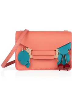 Coral leather (Cow) Tab-fastening front flap Designer color: Grapefruit Comes with dust bag Weighs approximately 0.7lbs/ 0.3kg Made in Italy
