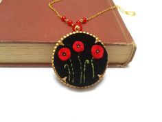 Poppies at night hand embroidered pendant necklace by ConeBomBom