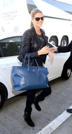 03a1ae8e9e69 Kate Upton Uses a Chanel Cerf Tote as a Carry-On - PurseBlog Chanel Cerf