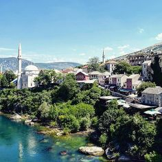 Houses and mosques line the banks of the Neretva River in Mostar Bosnia and Herzegovina. #LiveTravelChannel Photo by: @travelsewhere by travelchannel
