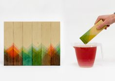London design studio Raw Edges has created a collection of zigzag-patterned furniture using pieces of wood that have been dipped into angled buckets of dye