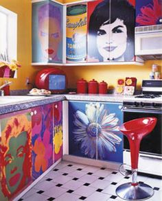 love the idea of paintings and pictures on kitchen cabinets. almost too cool.  Wish I had a painter in my family!