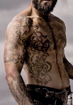 Vikings Season 3 Promotional Still ~ Starring : Rollo's right arm and tattoos. Clive Standen