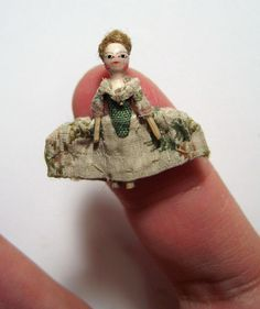 Tiny antique style doll