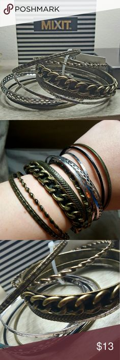 Metal bangle bracelets Metal bangle bracelets all different textures and styles.  NEW.  Has a bit of an antique look to them. Will ship fast! mixit Jewelry Bracelets