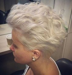 short blonde wavy hairstyle If you have short hair, but still desire a curly style, it does not get any better than these platinum brushed-back curls. You are able to incorporate texture into your tapered cut while still holding on to the overall edgy vibe.