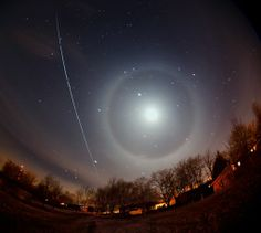 """On April 5th in Albany, Missouri, Dan Bush witnessed an ISS-lunar conjunction: """"The moon was surrounded by a beautiful ice halo when the space station passed by,"""" says Bush. """"This is a composite of eight 20-second exposures."""""""