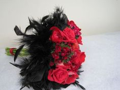 red bridal bouquet with black feather collar 1, Françoise Weeks Red Rose Black Feather Wedding Bouquet