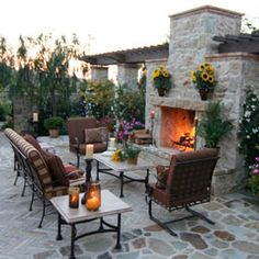 Outdoor oasis complete with stylish furniture, outdoor fountain and fireplace.