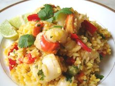Arroz con concha - Colorful spicy rice with scallops and vegetables