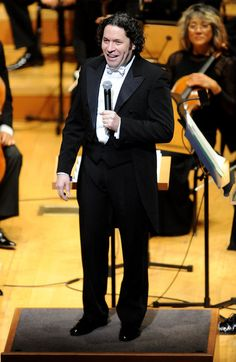 Conductor Gustavo Dudamel addresses the crowd at the Los Angeles Philharmonic opening-night gala celebrating the 10th anniversary of Walt Di...