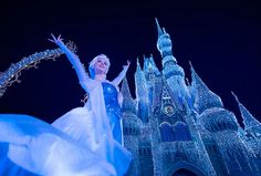 """Elsa uses her incredible powers to transform Cinderella Castle into a glimmering ice palace during """"A Frozen Holiday Wish"""" at the Magic Kingdom. (Disney)"""