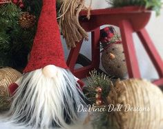 Swedish Norwegian TOMTE NISSE GNOME or SANTA can be Christmas Decor or all year round Decoration! Features bendable hat and arms to position any way you desire! Also added is a weighted bottom for extra stability!  There may be slight differences in ones pictured as each one is individually handmade , every thread stitched carefully with lots of love!  THE GNOME FEATURED FOR THIS LISTING, Has a red and heather grey striped hat with pine cone lightly glittered on the end. He is Carrying his…