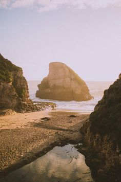 Discover Shark Fin Cove, one of California's hidden gems on your own Highway 1 road trip! This place is a photographers dream - find out why this place is a must-stop on the Pacific Coast Highway!
