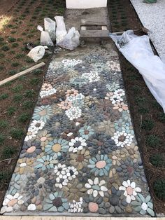 My pebble mosaic. I still have 6' feet to go. It takes about an hour per square foot.