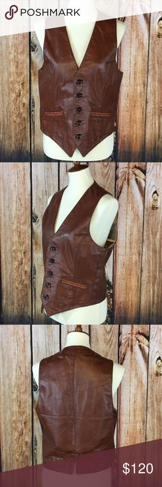 Cobbler's Classics Real Leather Vest w/ Pockets M Cobbler's Classics Real Leather Vest Button Front Lined with Pockets Size M Size M Real Leather Item is pre-owned. There is a small mark on the vest. Not sure if it was a leather defect or repair. Please use photos for a visual reference.   Measurements Laying Flat: Armpit to Armpit-18.5 inches Length-22 inches from shoulder to shortest point on vest at the bottom  E16 Cobbler's Classic Other