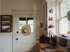Classic country kitchen with white cabinets and butcher block counters.