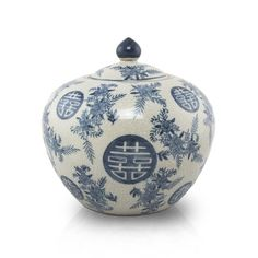 Cremation urn with floral accents and the Chinese symbol for double happiness.