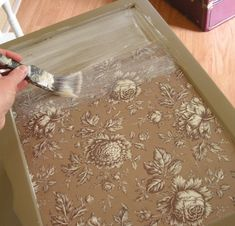 How to decoupage scrapbook paper onto a tabletop with Mod Podge by MarciaAMosher