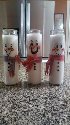 My little candle snowmen that I made using Dollar Tree candles. I used paint pens for the faces and an old shirt for the scarves. They cost a total of $3.00. #christmascandlesjars