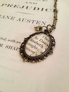 Elizabeth and Mr Darcy Pride and Prejudice Book Page Necklace. $15.00, via Etsy.