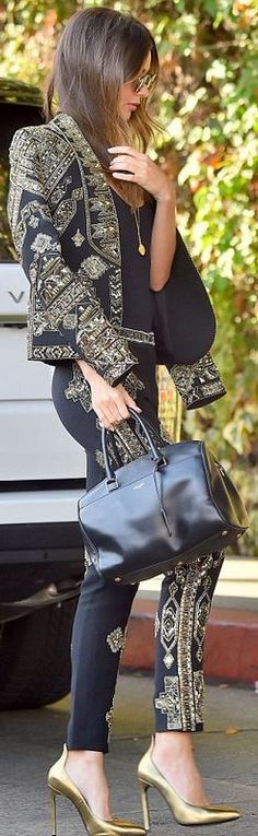 Who made Miranda Kerr's gold print blazer, jewelry, embellished black pants, leather handbag, and gold pumps