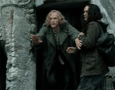 Dustfinger being protective of Farid.