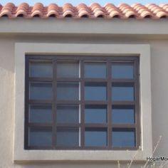Reja de hierro para ventana a cuadros grandes
