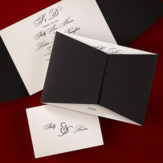 This elegant invitation has a black wrap that goes over an ecru colored card.