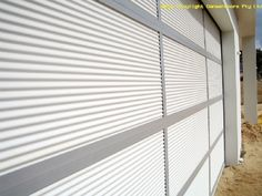 Garage door, with Mini Orb inserts on sectional Aluminium Frame. Thinking charcoal frame, and mini orb to match roof Custom Garage Doors, Custom Garages, Id Design, House Design, Perth Western Australia, New Home Designs, Blinds, Charcoal, New Homes