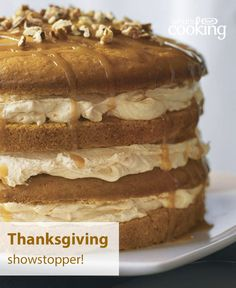 Piled high with 4 layers of perfectly spiced pumpkin cake and 3 fluffy mounds of cream cheese icing, this showstopper puts the best finishing touch on your #Thanksgiving feast. Click photo for this easy Luscious 4-Layer Pumpkin Cake recipe.