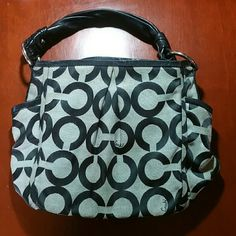 Coach Parker Op Art Shoulder Bag In GREAT loved condition, very roomy. For those of you interested in size, this, in my opinion, is a large bag...  Size: 10 1/2 (H) x 10 3/4 (L) x 5 (W). Op Art print fabric with light- weight leather trim.  Interior is super clean, no pen marks like my other bag. Exterior does have wear and few markings very faint...It can be cleaned!   Yes this bag is gorgeous and can be yours...NO trades Coach Bags Shoulder Bags