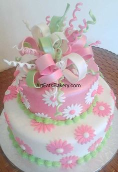 Art Eats Bakery 1626 East North Street, Greenville, SC 29607https://www.facebook.com/ArtEatsBakerySCGirl's pink, white and green daisy flowers and edible ribbons and bows unique fondant birthday cake designThe best custom designed unique #creative #modern birthday, baby shower and elegant romantic wedding cakes create a personal element to your party or reception that cannot be matched by decor or venue. It is the first thing your guests see at the party or re...