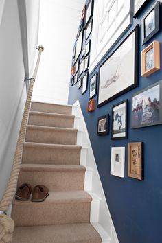 most of the major pieces hail from Crate & Barrel and West End.A nautical rope lends a hand as a witty alternative to the standard banister, while family photos and an eclectic art collection line the stairwell.   - CountryLiving.com