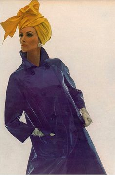 Wilhelmina in a violet vinyl coat by Modelia and hat by Adolfo, photo by Bert Stern 1965