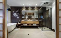 Dieses Bad schafft einen ruhigen Raum zum entspannen. Diese schöne Fliese Akzent Wand gleicht die hellen Farben, während der Rest des Raumes verwendet. Die Dusche Glas eingeschlossen hilft dieses Gesamtbild und bietet gleichzeitig einen separaten Raum.