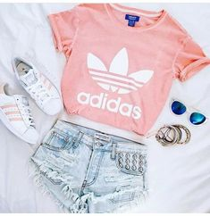 Pink Adidas shirt with matching shoes.