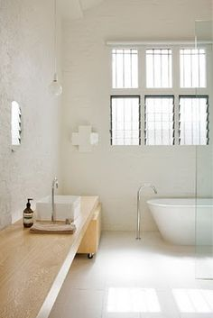 white/wood bathroom.