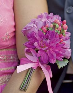 Corsage- Bridal party carried fans in this wedding and the bouquets were fastened to their arms. I love the colors of the flowers and how the bouquet was put together.
